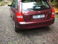 begagnad Mazda 323F lågmilare