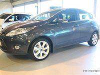 begagnad Ford Fiesta 1.4 TDCi 70 hk Titanium 5-d Halvkombi 2011